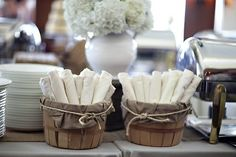 Cutlery wrapped in napkins for buffet table