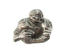Huge Football Player Belt Buckle Limited Edition by the Great American Buckle Co, Chicago. Heavy cast metal. This is numberered 800 and dated 1980. The Football player is wearing number 47. Measures 3 L X 2.75 H. Will fit a buckle that is 1.75 in height or smaller. Great for the fan or player!  Check out our other ETSY Shop items at www.etsy.com/shop/PremierAntiquesNY