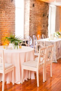 Ooh Events' White Washed Circle Chairs | Modern Charleston Wedding at The Historic Rice Mill by Charleston Wedding Planner ELM Events