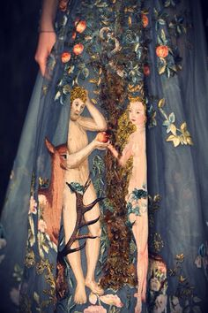 """Valentino spring 2014 couture collection- """"Le jardin d'Eden"""", a zirconium-colored tulle dress, embroidered in silk threads, with a scene of Adam and Eve in the Garden of Eden inspired by the painting """"Adam and Eve"""" by Lucas Cranach in 1526, taking 2,200 hours to hand embroider."""