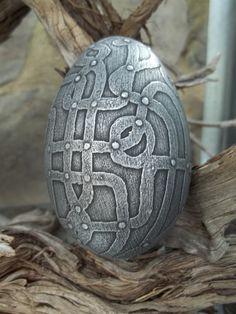 Acid etched goose eggshell. Medieval cage.