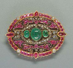 A late 19th century ruby, emerald and diamond brooch, circa 1880,
