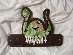 Solid wood handcrafted and handpainted plaque. Made for a little boy that loves dinosaurs and hunting with his dad! Adorable!