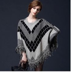 """Women's Tassel Poncho Sweater High quality, loose fit and comfortable. Perfect cover up to keep you warm. Pair it with your favorite jeans and boots.                                                                  Material: Cotton, Wool.                                              Size Details: One Size: LENGTH: 24.8""""        SHOULDER: 22.8""""                                                           Add to Cart 🙂 Sweaters Shrugs & Ponchos"""