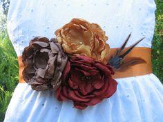 Autumn wedding sash belt fabric flower and feather ribbon sash. $40.00, via Etsy.