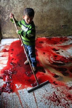 Palestinian Kid by Rj Stitt,يا لطيف. via / Palestinian Kid cleaning up after the slaughter of a cow in his parents slaughterhouse, Nr Ramallah, Palestine. Mundo Cruel, Heiliges Land, Save The Children, Syrian Children, Poor Children, Precious Children, We Are The World, My Heart Is Breaking, Just In Case