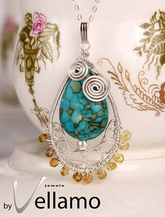 December birthstone, tear drop pendant with mosaic turquoise gemstone, wire wrapped with sterling silver and tourmaline. $59.00, via Etsy.