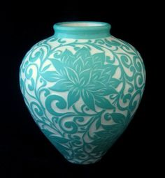 Sgraffito - glazing and then carving the glaze to reveal the underclay