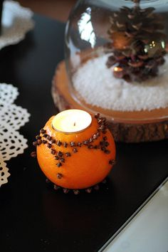 The classic clove-studded citrus craft gets an unexpected upgrade when used to hold a tealight. Plus, the soft warmth of the flame brings out more of the scent. See more at Adventuress »