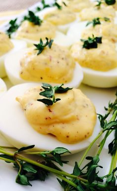 {French} Deviled Eggs - Dijon Mustard, Red Wine Vinegar, Shallots, Lemon Juice, Thyme http://leftsideofthetable.com/2014/03/31/french-deviled-eggs/
