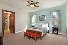 Master bedroom with dual faced windows and connecting master bathroom