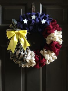 Patriotic wreath made from ABU uniform, burlap, & yellow support our troops ribbon. American flag DIY