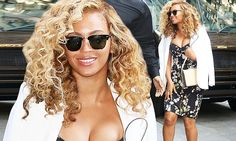 Beyonce shows off extreme cleavage in eye-popping floral dress