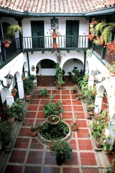View of a courtyard of a guest house in the colonial town of Villa de Leyva in Colombia. Villa de Leyva is considered one of the best preserved colonial villages in Colombia and is a National Monument. Tags: accommodation homes portrait Hacienda Style Homes, Mediterranean Style Homes, Spanish Style Homes, Spanish Home Decor, Spanish House Design, Mediterranean House Exterior, Spanish Style Interiors, Mediterranean Living Rooms, Spanish Interior