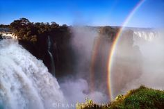 Rainbow over Victoria Falls, Zimbabwe by Frans Lanting