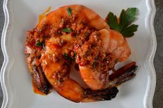 Grilled tiger prawns get their zippy flavor from Peri-Peri, a favorite marinade crafted by chef Elizabeth Binder of 'Top Chef' fame. Peri Peri Marinade, Prawn Sauce, Grilling Recipes, Cooking Recipes, Grilled Prawns, Prawn Recipes, Chimichurri, Food Lists, Tandoori Chicken