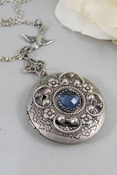 Tranquility,Locket,Antique Locket,Silver Locket,Bird,Sapphire,Blue,Ocean,Bird Locket,Bird Jewelry. Handmade jewelry by Valleygirldesigns.