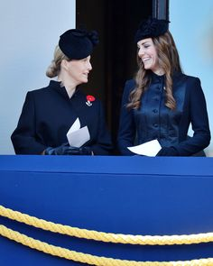 Catherine, Duchess of Cambridge, aka Kate Middleton, with Sophie, Countess of Wessex, attending the ceremonies in Whitehall marking Remembrance Sunday. Kate is wearing the 'Noa' coat by Temperley London, Fairy Tale hat by Sylvia Fletcher for Lock and Company, her Cornelia James Gloves with Bow, and the Buckley Crystal Poppy Brooch. 11/10/13