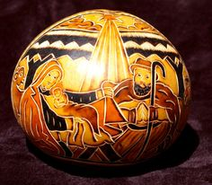 Hand Carved Gourd, etched and burnt to give color and texture.  From the Andean region of Peru.  Available at www.itscactus.com