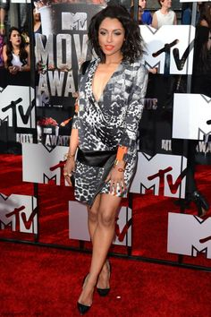 "The star of ""The Vampire Diaries"", actress Kat Grahm was dressed in Roberto Cavalli animal print mini dress and accessorized with Neil Lane jewelry at 2014 MTV Movie Awards."