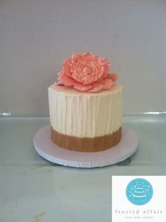 Elegant buttercream cake with edible peach flowers and gold accents!