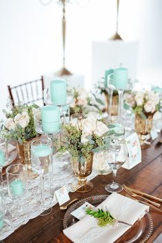 For a Rustic vintage wedding, a lace runner, mint green candles and blush roses
