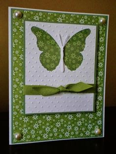 handmade card ... apple green and white .. negative space die cut butterfly window in top layer shows the tiny flower print paper of the background ... grosgrain ribbon tied in a know around top panel ... luv it!