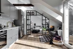 [Room] Small attic apartment in Stockholm, Sweden uses an industrial glass wall to partition the bedroom from the rest of the space. × [Room] Small attic apartment in Stockholm, Sweden uses an industrial glass wall to partition the be Industrial Apartment, Attic Apartment, Attic Rooms, Attic Spaces, Attic Bathroom, Studio Apartment, Attic Playroom, Stockholm Apartment, Dream Apartment