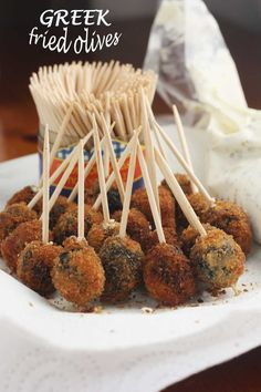 Juicy olives stuffed with feta cheese and oregano and fried in crispy breadcrumbs. What an easy-to-make canapé!