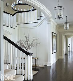 Defined by sleek interior architecture and a simple palette of black and white, the foyer sets a sophisticated tone. Foyer Staircase, Entry Hallway, Stairs, Staircases, New England Style, New England Homes, New Homes, Interior Architecture, Interior And Exterior