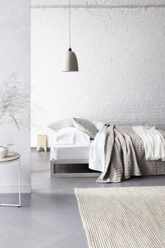 Gorgeous minimal design - bedroom with white brick wall
