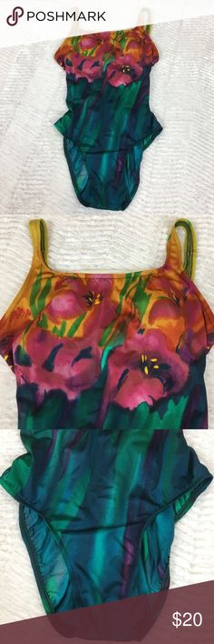 """Vintage Jantzen Floral High Cut One Piece Swimsuit Vintage 80s one piece swimsuit. Jantzen. Green, blue, pink, yellow. Floral. Square neckline. High cut. Padded bust. Size 12z  Excellent preowned condition with no flaws.  Measurements are approximately: 30"""" bust, 23"""" waist, 24"""" hips, and 27"""" length.  82% Antron Nylon 18% Lycra spandex.  No trades. All items come from a pet friendly home. Bundle to save! Vintage Swim One Pieces"""