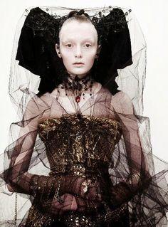 Elaborate costume. black tulle.  gold corset.