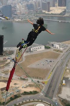 i didn't know this before! should try this! Bungee jumping off the Macau Tower, the world's highest bungee jump.