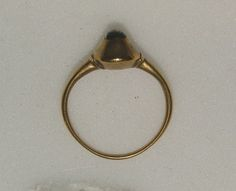 Probably England 12-13 c  Gold ring, the oval pie-dish bezel set with a cabochon sapphire; 18.75 mm ring dia; 4.28 g   WA1897.CDEF.F355  The sapphire was a popular stone in the Medieval times and was actually believed to protect the wearer against fraud and protect their chastity.  Taylor and Scarisbrick, Finger Rings from Ancient Egypt to the present day, 1978, no. 296