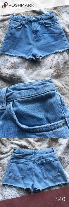 """Topshop Mom Moto Jean Shorts Topshop Mom Moto Denim distressed shorts. Only worn twice, EUC. Tag says USA size 4 but as all topshop clothing, runs small. Waist measures 24"""". High waisted. Topshop Shorts"""