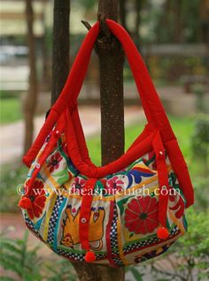 Red Colored Elephant & Flower Embroidered Banjara Bag Pattern 1 Rs. 1186 Our price is inclusive of GST taxes Elephant and flower printed banjara bag has the comfortable strap to hang on the shoulder. The work is on both sides of the bag.  size -  Lenght: 11 inches  Width:21 inches