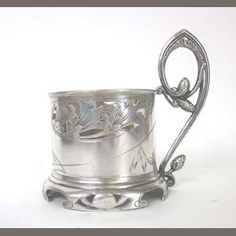 A Russian Art Nouveau silver lemon-tea glass holder. c.1896-1908.