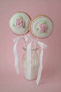 Rose fondant cookie lollys.  Would be cute with button molds too!