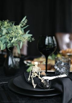 Host a Halloween Themed Dinner Party in Black to celebrate the holiday in a more adult way. Add some spooky skeletons to your Halloween place setting.