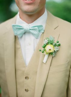 Dahlia bud, green berries & dusty miller. Love how this boutonniere compliments his mint bowtie!