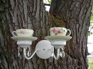 Tea cup birdfeeder.  Cute, but at my house it would most likely end up a squirrel feeder.