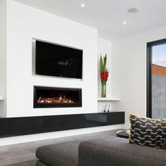 The award winning Seamless Landscape Gas Fireplace fits perfectly into this modern home design. Wooden Fireplace, Home Fireplace, Living Room With Fireplace, Fireplace Design, Fireplace Ideas, Fireplace Candles, Fireplace Makeovers, Ethanol Fireplace, Home Design