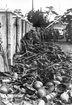 German soldiers discarded their small arms and helmets before being evacuated from Pillau in April 1945.
