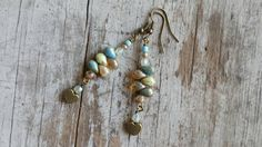 Check out this item in my Etsy shop https://www.etsy.com/listing/264995568/bohemian-blue-beach-earrings-rustic