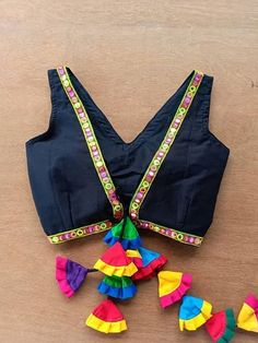 Black sleeveless blouse with tassles multicolored