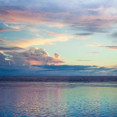 The lavender and pink of the skies reflecting on the water, the pale blue in the sky melding to dark smokey-blues meeting at the horizon, all combine in a perfect medley of color.