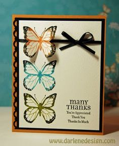 I like the dimension of the second orange butterfly layered over the first one.  [Card by http://darlenedesign.com/wordpress/]