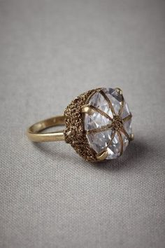 Vintage 18K gold ring with wrap-pronged white sapphire