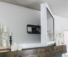 How to make a cheap and easy DIY TV frame for your wall-mounted TV. This white TV frame is simple, lightweight, and swivels with your TV. Tv Holder, Bedroom Tv Wall, Bedroom With Tv, Tv Wanddekor, Plasma Tv Stands, Mirror Tv, Swivel Tv Stand, Tv Wall Decor, Diy Wall